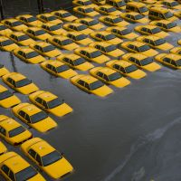 Yellow peril: A parking lot full of cabs in Hoboken, New Jersey, lies flooded Oct. 30 in the wake of Superstorm Sandy. Last year was the third in a row that 19 named tropical storms hit the U.S. | AP