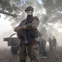 Angel of death?: A French soldier wearing a skeleton mask stands next to an armored car in Niono, Mali, on Sunday.   AFP-JIJI