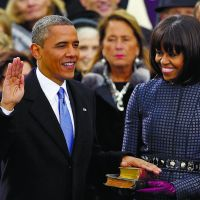 Encore: President Barack Obama receives the oath of office from Chief Justice John Roberts as first lady Michelle Obama holds two Bibles and watches during the ceremonial swearing-in at the U.S. Capitol in Washington on Monday. | AP