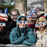 Eyewitnesses to history: Americans celebrate the ceremonial swearing-in near the U.S. Capitol on Monday. | AFP-JIJI