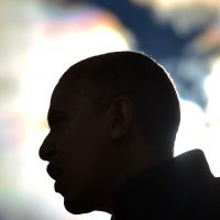 Black power: President Barack Obama is silhouetted during a campaign rally speech in Concord, New Hampshire, in November. | AFP-JIJI