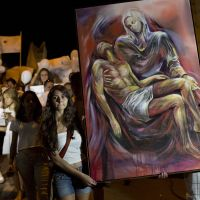 Seeking solace: A Pieta is carried Monday by marchers in Santa Maria, Brazil, honoring the victims of the fatal fire at the Kiss club. | AP
