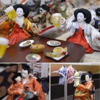 Empress hina dolls attending a 'joshi-kai' (women-only party) raise beer mugs while their male counterparts are at home looking after the baby and hanging the laundry.  | KYODO PHOTO