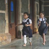 Boys first: Schoolgirls play in Mumbai's Bandra Station as they wait to catch a train Wednesday. A new study says India's swelling urban middle class may be using illicit sex-selective practices. | AP