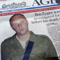 Uncovered: Suspected former Mossad agent Ben Zygier is seen on the front page of an Australian newspaper. | AFP-JIJI