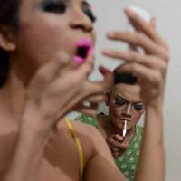 Community spirit: Transgender women Hera (left) and Rica prepare for a night out in Jakarta. A home for elderly transgender people recently opened in the Indonesian capital. | AFP-JIJI