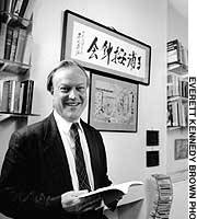 Nicolas Maclean at his London residence,  in front of calligraphy done by fomrer Japanese Prime Minister Yasuhiro Nakasone