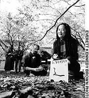Patricia Wakida and staff members of Kyoto Journal collect autumn leaves for insertion into a special issue of the award-winning quarterly.