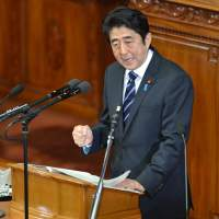 Doing it his way: Japanese Prime Minister Shinzo Abe pledged on Jan. 28 that he would not keep stimulus spending 'forever' in a policy speech ahead of a budget that will raise more in taxes than it does from borrowing. | AFP-JIJI