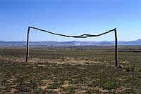 Goalposts in Nqutu, South Africa (above) photographed by Neville Gavle; Alistair Berg turns his lens on fans, like these Scotland supporters (below)