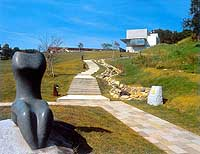 'Moon and Sky' (1993) by Kenji Tomita, made for the Iwate sculpture symposium, sits in front of Ishigami-no-Oka in Iwate; Kate Thomson (below) with her recent work 'Changing Perspectives'   PHOTO COURTESY OF IWATE TOWN HALL/VICTORIA JAMES PHOTO