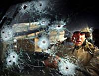 Private Eric Ayon of Echo Company of the second batallion, Fourth Regiment of the US marines stares through the bullet-ridden windshield of a Humvee ambushed at Ar Ramadi,Iraq, on April 6. Second prize general news singles in the World Press Photo exhibition.