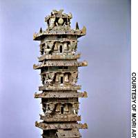 This ceramic watchtower (above) was placed in a tomb to protect its occupant during the Eastern Han dynasty (25-220 A.D.); a detailed photo of a carved panel on a stone sarcophagus, showing a lion battling a bull. It was built for Songdian provincial governor Yu Yong and dates to 592 A.D.