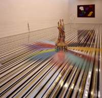 Jim Lambie's room at the Tokyo Opera City Gallery includes the individual works (left to right): 'Psychedelic Soul Stick'; 'The Byrds (Right On)'; 'Bodyrox'; and 'Don't Fight It, Feel It'