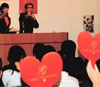 Tetsuji Shibayama and student Miyuki Gobara acting as auctioneers for Kyoto University of Art and Design's A-CTION art auction.   LUCY BIRMINGHAM PHOTOS