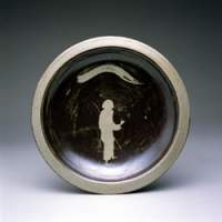 Plates by Bernard Leach, 'The Pilgrim' (top; 1960) and an untitled one from 1954 | COURTESY OF THE SHIODOME MUSEUM