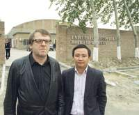 Waling Boers and Pi Li are awaiting the construction of sidewalks outside of their Boers-Li Gallery in Caochangdi.