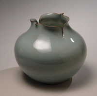 Celadon vase in bulbous shape with pinched points and cut openings at its raised mouth (above) and mizusashi water jar, with pinched points