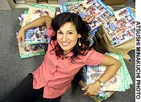 Tokyo-based Safia Minney (above) reclining on recently printed copies of the summer 2003 People Tree brand catalogue of her Fair Trade Co., and (below) in the arms of some of her Tokyo staff.
