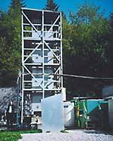 Fred Koch stands beside his reactor tower at the University of British Coluwhere struvite crystal pellets are extracted.
