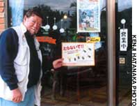 Yours truly (above) with a sign in Kunigami, northern Okinawa, imploring people not to poach the long-armed scarab beetle.