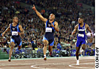 After what was a clean sweep of the medals by athletes with African ancestry in the men's 100-meters final at the 2000 Sydney Olympics, American Maurice Greene (center) celebrates his win in 9.87 secs ahead of Ato Boldon from Trinidad and Tobago and Obadele Thompson (right) from Barbados, as Greene's compatriot, Jonathan Drummond, looks on (left).