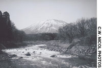 Theo Tori River (with Kurohime mountain behind) in 1998, three years after river construction (above); The same view from my study last month shows the bouldered banks' tree growth.