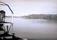 The empty, pristine shore of Great Bear Lake (above), the largest lake entirely with in Canada's borders, seen from the deck of the M.V. Radium Gillbert in the summer of 1964.