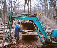 Making woodchips the easy, but very noisy way, from logs and branches trimmed out to improve our woods.