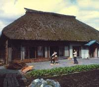 C.W. Nicol's first house in Kurohime had a traditional Japanese thatched roof, which accumulated a thick blanket of snow in the winter. | C.W. NICOL PHOTOS