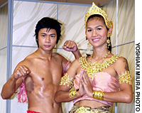 Actor and Muay Thai expert Asanee Suwan (left) plays gender-bending kickboxing champ Parinya Charoenphol (right) in 'Beautiful Boxer.'