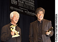Director Kichitaro Negishi and actor Koichi Sato revel in the moment Oct. 30, after their film 'Yuki ni Negau Koto (What the Snow Brings)' was honored with three prizes -- Sakura Grand Prix, Best Actor and Best Director -- at the 18th Tokyo International Film Festival.