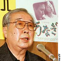 Shohei Imamura speaks in front of a poster for 'Unagi (The Eel), during a news conference in Tokyo in May 1997.