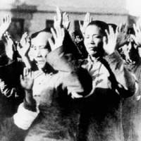 Chinese citizens hold their hands up in the documentary 'Nanking,' directed by Bill Guttentag and Dan Sturman | THINKfilm