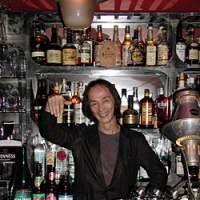 Yoshimitsu Fukui, known as Boy, has created a world to his own liking with Baar Gattaca in Shibuya. Left, customers sample the wide drinks selection. | JUDE BRAND PHOTOS