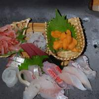 Super-fresh seafood is prepared and served by young staff (below).