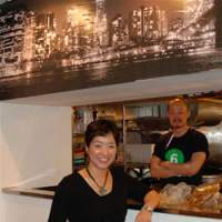 Owner Suji Park stands proud at her restaurant Suji's, as manager Kyu Chah looks on from the kitchen; the spicy Mexican scrambled eggs with chorizo and salsa (below) are a popular staple with the all-day brunch crowd. | ROBBIE SWINNERTON