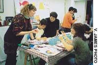 Kristin Newton (left) and Yoshiko Koga (standing center) guide students in an advanced color class.