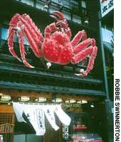 A large mechanical crab beckons at crab restaurant Kani Shogun in Sapporo.