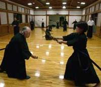Iaido master Esaka Seigen (left) and a pupil practice in his Tokyo dojo.
