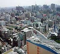 The view from the 25th floor of the Bunkyo Ward Office in Korakuen, where many of the buildings within screaming range of Tokyo Dome City's roller coaster are following the city's trend in being put to new and varied uses.