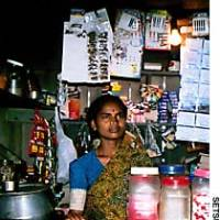 A woman named Pappamma in her shop  in the Kuduremala slum in Mysore -- the first business started there with a loan from a self-help group's trust fund.