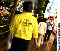 A Kabukicho clean-up campaigner on patrol
