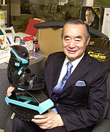 Japan's most famous inventor, Yoshiro Nakamatsu, otherwise known as 'Dr NakaMats,' proudly shows off his Flying Shoes. (Yoshiaki Miura Photo)