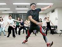 Walking guru Duke Saraie energetically leads his flock of exercisers in one of his recent 'Dukeswalk' classes in Tokyo.