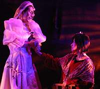 A wedding scene between a disfigured transsexual and a woman whose legs stop at the knees