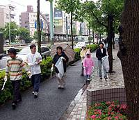 Local residents and students from Tokyo's Waseda University out in the rain last month on an annual Gomi-zero (No rubbish) Day Clean Patrol organized by a neighborhood retailers' group.