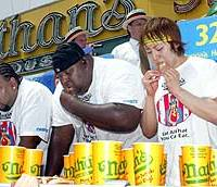 Takeru Kobayashi eats his 32nd hot dog at Nathan's Famous Fourth of July hot dog eating contest on New York's Coney Island in 2003. (AP PHOTO)