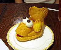A  cream puff made in the form of one of the golden killer whales atop Nagoya Castle