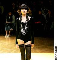 One of the dark and introverted looks from Limi Yamamoto's latest catwalk collection